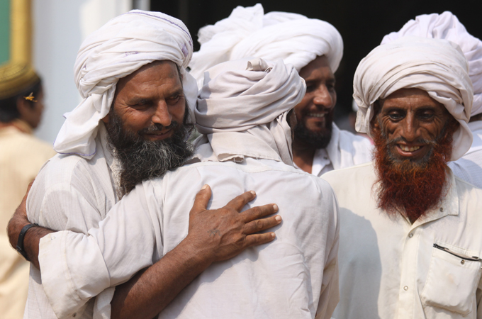 Indian Muslims hug as they greet each other after the prayers at the Jamia mosque on the occasion of Eid-al-Fitr, in the northern Indian city of Amritsar.