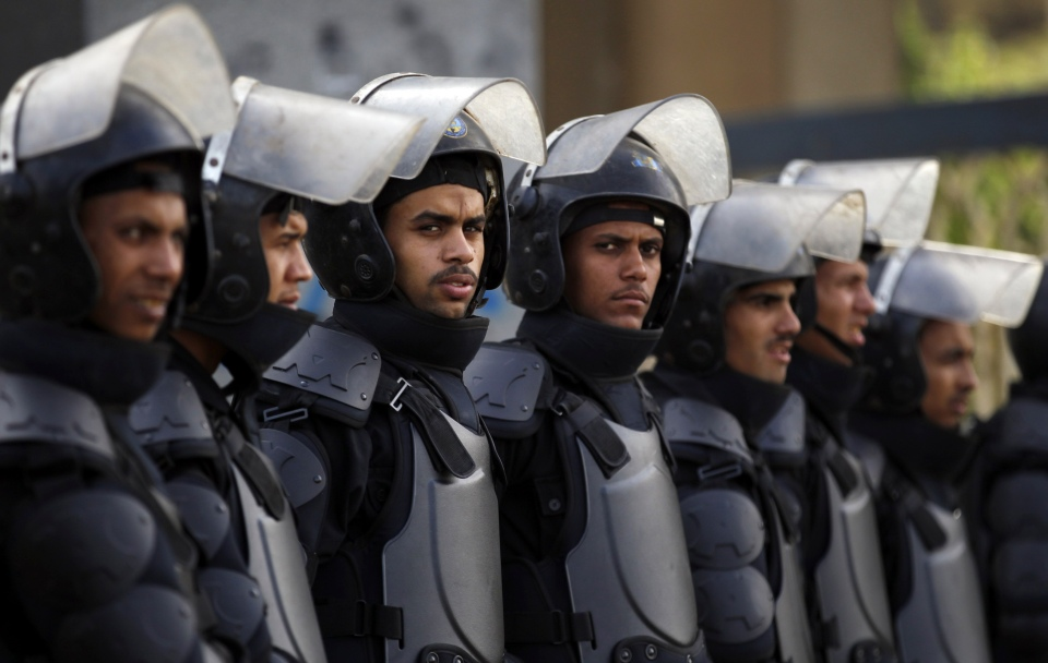 Riot police take positions as Al-Azhar University students, who are supporters of the Muslim Brotherhood and ousted Egyptian President Mohamed Mursi, block Moustafa Al Nahas street in front of Al-Azhar University Campus