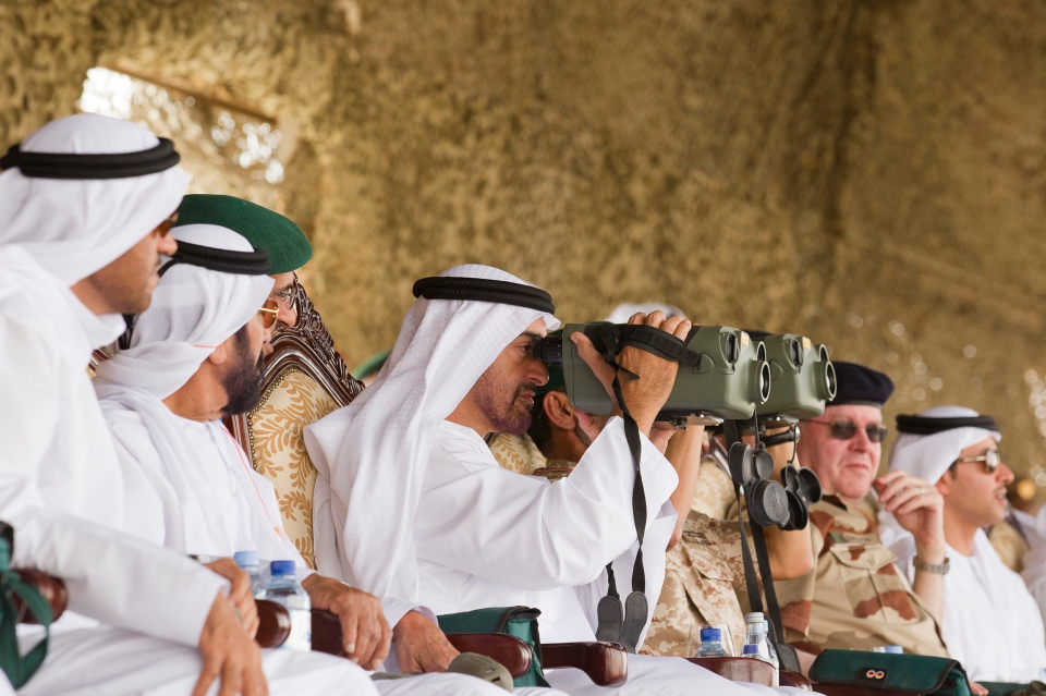 Abu Dhabi Crown Prince Sheikh Mohammed Bin Zayed Al Nahyan (C) watches the closing ceremony during joint military manoeuvres between the UAE and the French army in the desert of Abu Dhabi