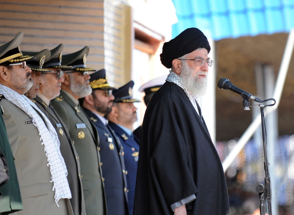 In this photo released by the official website of the Iranian supreme leader's office, Iranian supreme leader Ayatollah Ali Khamenei, right, stands at the podium in front of high ranking armed forces members, during a ceremony in a military university, in Tehran, Iran, Thursday, Nov. 10, 2011. Iran's supreme leader on Thursday warned Israel and the United States that Tehran's response will be tough should its archenemies choose a military strike against Iran over the country's controversial nuclear program. (AP Photo/Office of the Supreme Leader) EDITORIAL USE ONLY  NO SALES