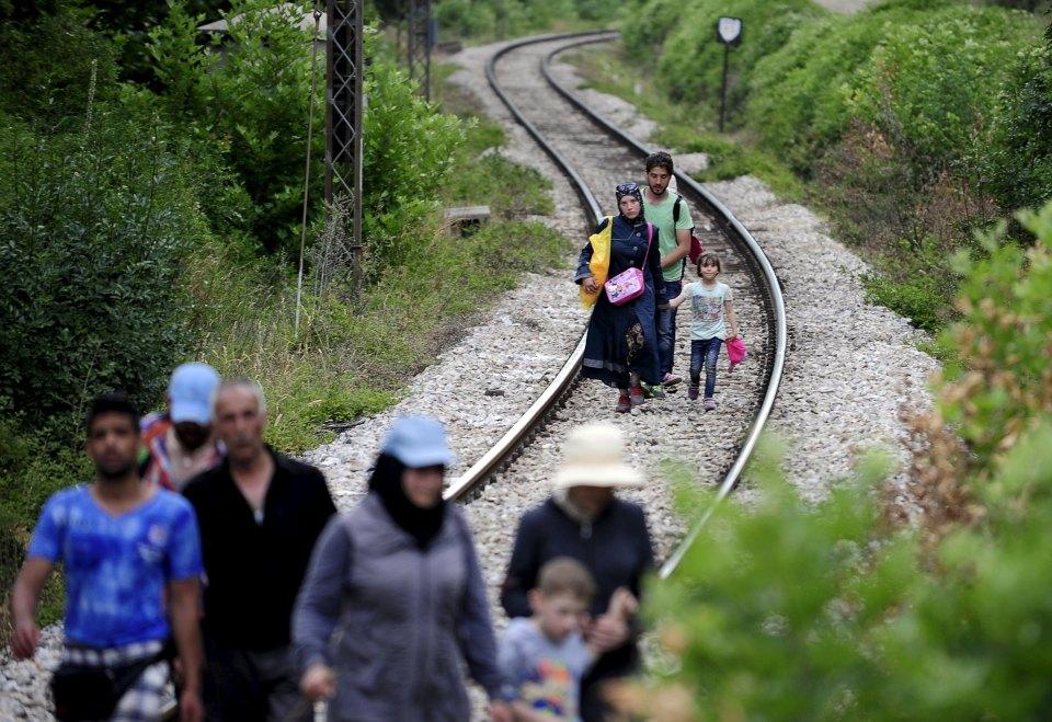 Migrants from Syria walk in Macedonia near the Greek border