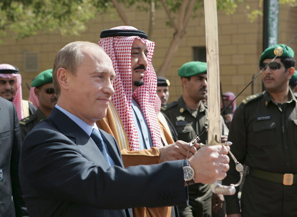 Putin and King Salman bin Abdul Aziz hold swords in Riyadh