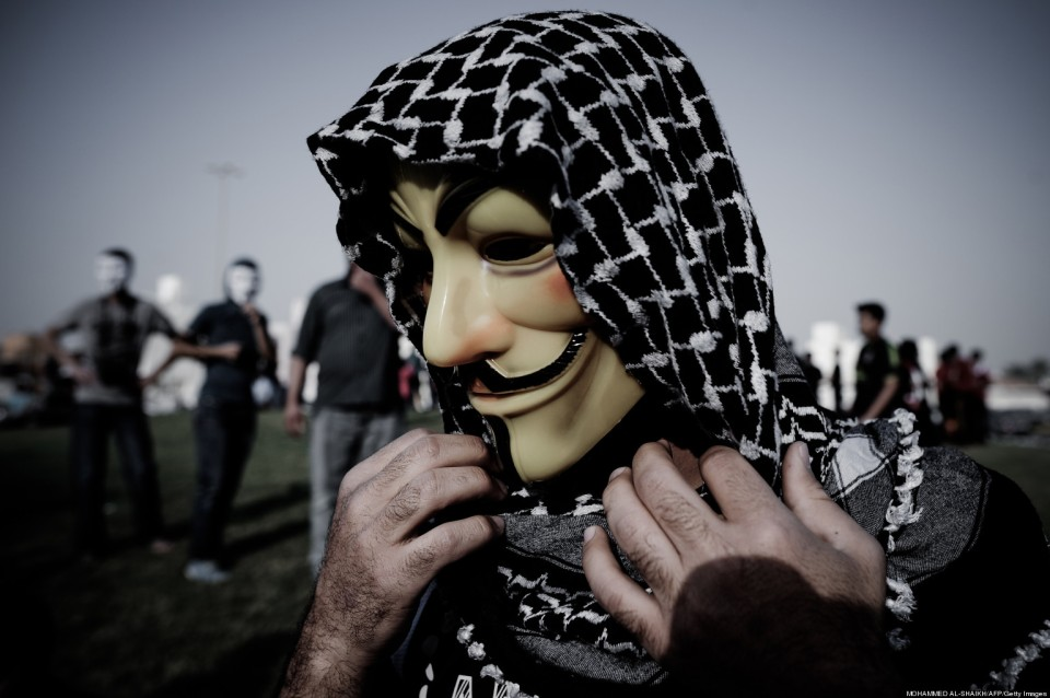 A Bahraini protester wearing a Guy Fawkes mask used by the Anonymous movement takes part in a demonstration against the government and in solidarity with jailed freelance photographer Ahmed Humaidan in the village of Karranah, west of Manama, on March 1, 2013. Humaidan was arrested during a rally on December 29, 2012 and was charged with