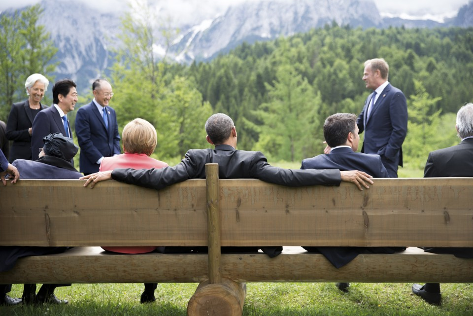 German Chancellor Merkel sits with U.S. President Obama on a bench outside the Elmau castle in Kruen